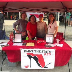 Four female leaders behind red table - National Federation of Republican Women