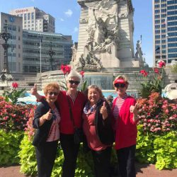 Four people posing in front of a sculpture - National Federation of Republican Women