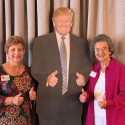 Two ladies posing with Trump's life size poster - National Federation of Republican Women